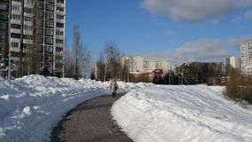 Woman is walking along the boulevard in Moscow, Russia. The woman is walking along the boulevard in Moscow, Russia stock footage