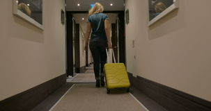 Woman Walking along the Hotel Passage with Trolley stock video footage