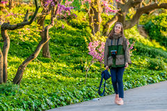 Woman walking along park trail in spring day. Barcelona, Catalonia. Royalty Free Stock Image