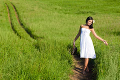 Woman walking along the road Royalty Free Stock Photography