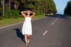 Woman walking along the road Royalty Free Stock Photo