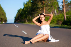 Woman walking along the road Stock Photography