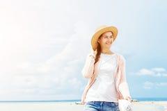 Woman walking along the sea royalty free stock photos
