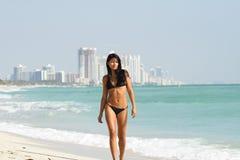 Woman Walking Along The Shore Royalty Free Stock Photo