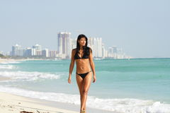 Woman Walking Along The Shore Royalty Free Stock Image