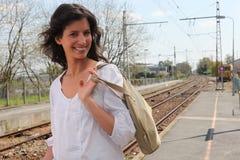 Woman walking along train platform Royalty Free Stock Images