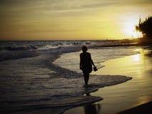Woman Walking Along Tropical Beach At Sunset Royalty Free Stock Photography