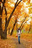 Woman walking in autmn park Royalty Free Stock Images