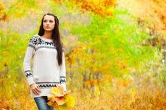 Woman walking in autmn park Stock Images