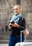Woman walking in autumn city with digital camera Stock Images