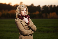Woman walking in autumn field. Sad young woman walking in autumn field Stock Images