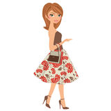 Woman walking. Woman in autumn floral dress with shopping bag and purse Stock Image
