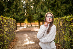Woman walking in autumn garden near garden Royalty Free Stock Image