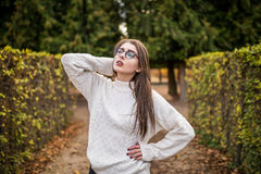Woman walking in autumn garden near garden Royalty Free Stock Photos