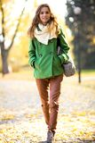 Woman walking in autumn park Stock Image