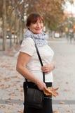 Woman walking in autumn   park Royalty Free Stock Photo