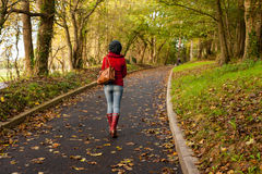 Woman Walking through autumn park Royalty Free Stock Photo