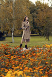 Woman walking in the autumn park with umbrella Royalty Free Stock Images