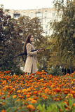 Woman walking in the autumn park with umbrella Royalty Free Stock Photos