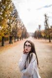 Woman walking in autumn Royalty Free Stock Photo