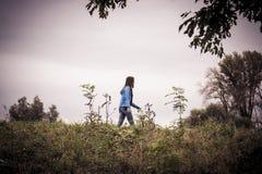 Woman walking away Stock Image