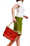 Woman walking with bag. Woman in green skirt walking with red bag, on white stock images
