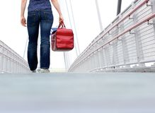 Woman walking with bag outdoors Royalty Free Stock Photo