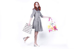 Woman walking with bags from the store Royalty Free Stock Photo