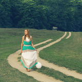 Woman walking with balloon in hand Royalty Free Stock Images