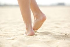 Woman walking barefoot on sand Royalty Free Stock Photography