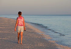 Woman walking beach Royalty Free Stock Photos