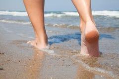 Woman walking on beach Stock Photography