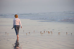 Woman Walking on Beach Royalty Free Stock Images