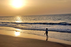 Woman walking on the beach. Sunset in Oman - woman walking Royalty Free Stock Photography