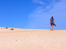 Woman walking on a Beach stock photography