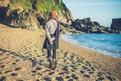 Woman walking on beach in autumn Stock Photo