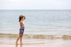 Woman walking beach Stock Images