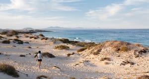 Woman walking on beach Stock Photo