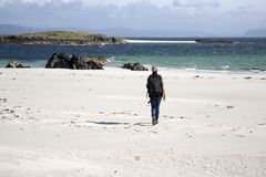 Woman walking on Beach in Isle of Iona stock photography