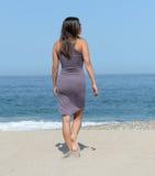 Woman walking on a beach Stock Image