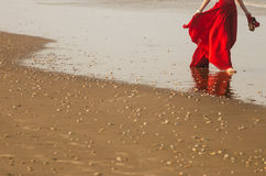 Woman walking on the beach Stock Photography