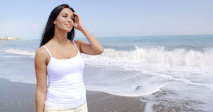 Woman Walking on Beach and Smiling at Camera stock footage