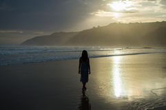 Woman Walking on the Beach during Sunset in Wilderness, South Af Royalty Free Stock Photo