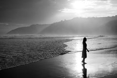 Woman Walking on the Beach during Sunset in Wilderness, South Af Stock Photo