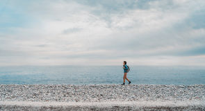 Woman walking on beach Stock Photos