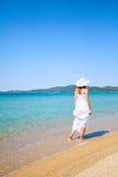 Woman walking at the beach Stock Image
