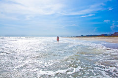 Woman walking at a beautiful beach Royalty Free Stock Photos
