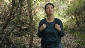 Woman walking through beautiful jungle. Hiking outdoors on nature - pretty woman walking through beautiful jungle. Walking the trek with backpack stock footage