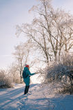 Woman walking in beautiful winter forest Royalty Free Stock Photos
