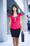 Woman walking with briefcase Royalty Free Stock Image